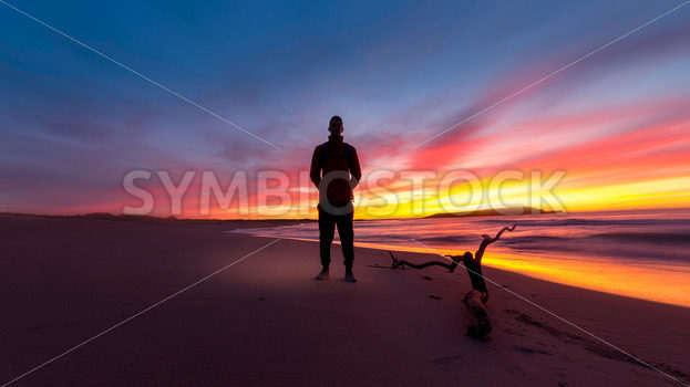 Man on Beach at Sunset - Symbiostock Express Demo